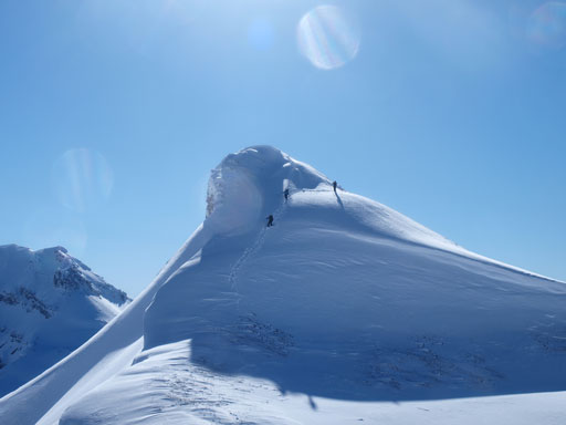 Josee, Fabrice (golden scramblers) and their friend coming down from the false summit