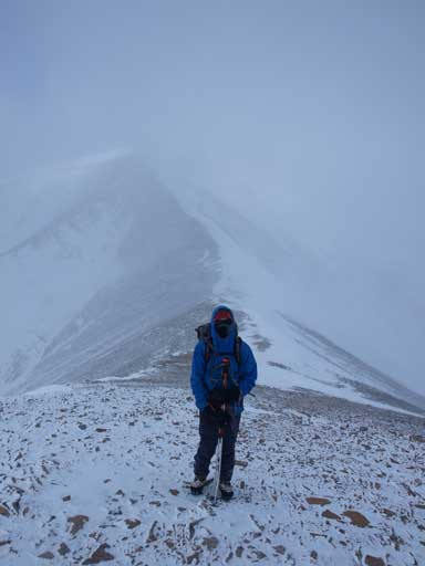 Ben on the summit ridge. Weather was quite miserable.
