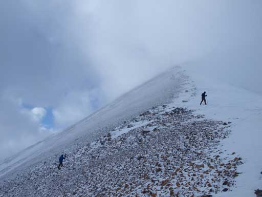 Descending the summit ridge.