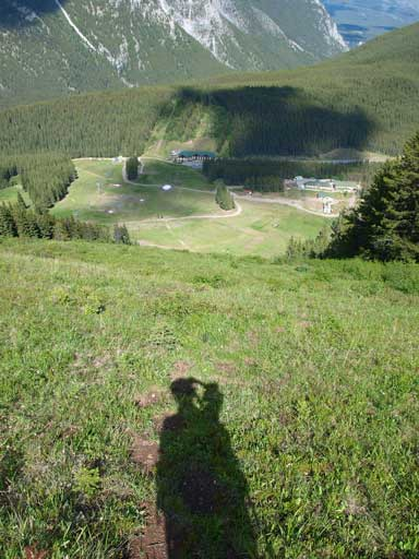 Looking down the steep grass slope (Black ski run)