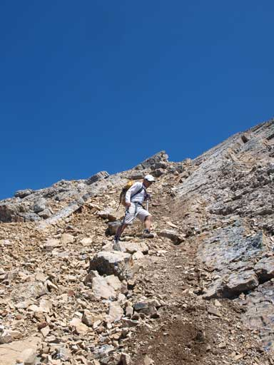 Dan descending the typical terrain.