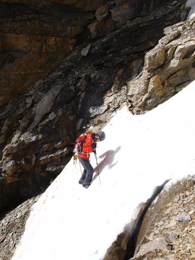 Mike crossing a tricky snow gully without crampons