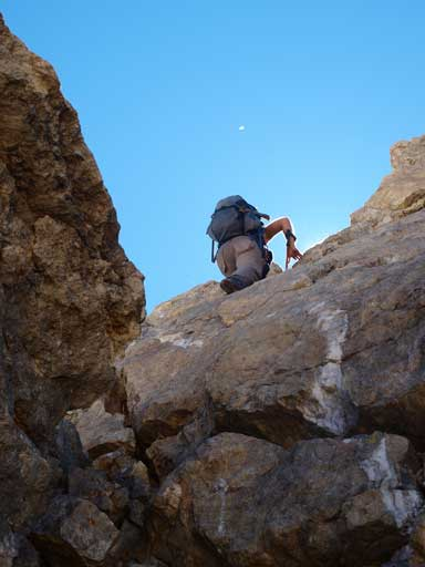 Andrea down-climbing the crux