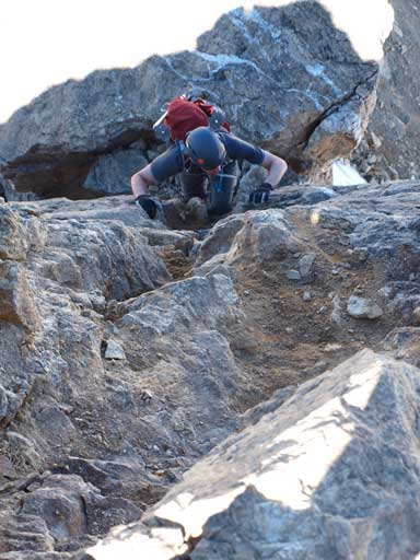 Mike finishing the crux