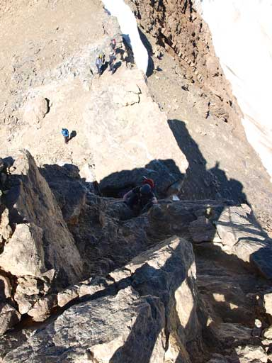 Mike ascending the crux just below the summit of Mt. Pollinger