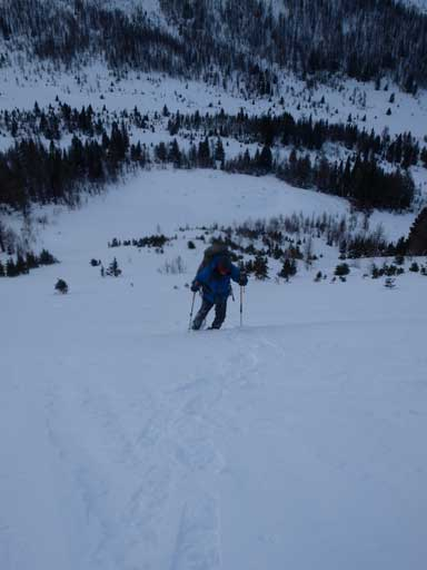 Ben snowshoeing up the steep avalanche slope