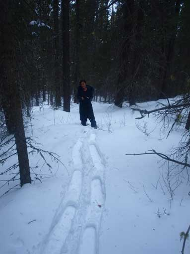 Mom following my tracks up the forested slope