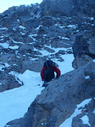 Carefully down-climbing another snow gully