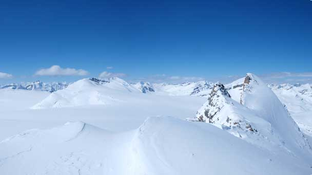 A wide shot from the first bump on the summit ridge. You can see the false summit and true summit on right.