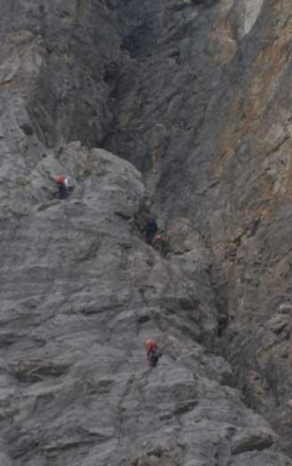 Rock climbers above