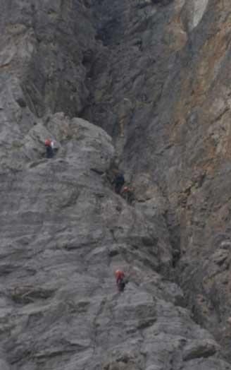 Rock climbers above