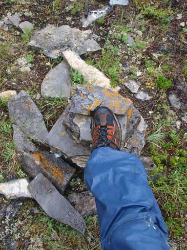 Me stepping on the smaller summit cairn
