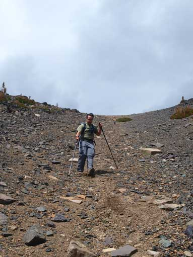Scree skiing down the upper gully