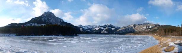 Panorama of the frozen Barrier Lake. Mount Baldy on left