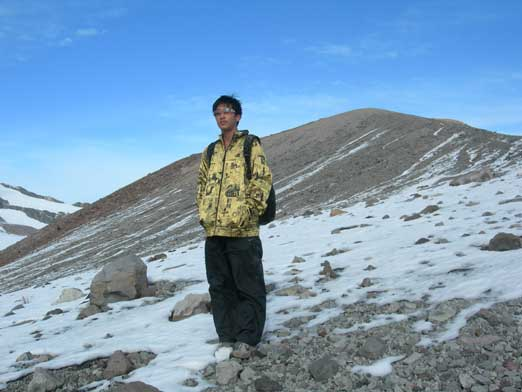 Me topping out on the crater. Behind me is one of the highpoints on this Cone