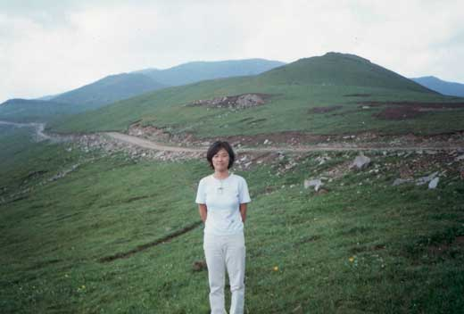 Mom with the mountain road behind.