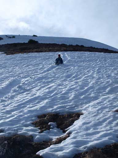 We glissade down the only bit of snow on our descent route