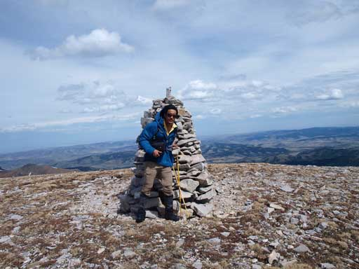 Me with the big cairn on first summit. As you can see, it was extremely windy. We could barely take this shot
