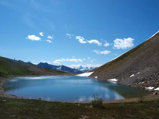 Harvey Lake sits at Harvey Pass. Assiniboine poking behind