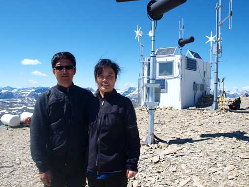 Dad and mom on the summit, with the weather station behind.