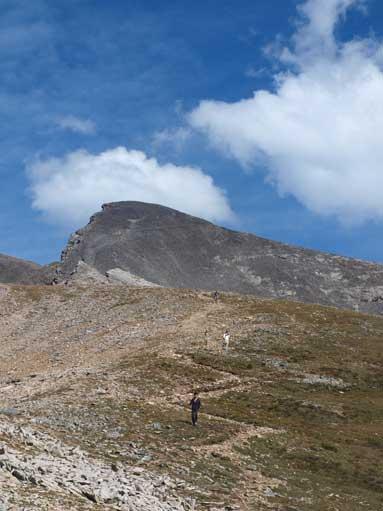 Following trails down towards 1st peak. Looking back towards false summit