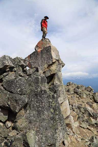 Me standing on the true summit pinnacle. Photo by Ben N