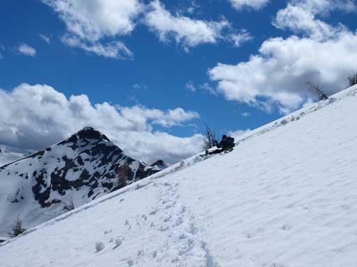 Ben glissading down the mountain