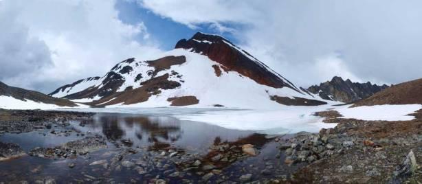 At Kerr Lake, Mount Kerr behind. Note the rock band guarding the summit.