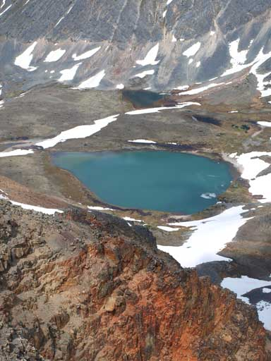Another alpine tarn, and note the reddish/orange colour rocks