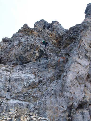 Neil down-climbing the steep terrain