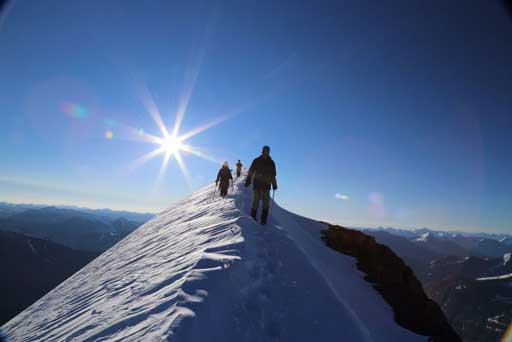 Descending the summit ridge. Photo by Ben N