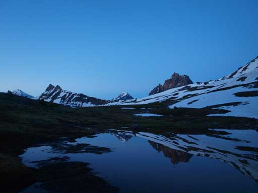 Oldhorn Mountain and its reflection in a tarn near Maccarib Pass