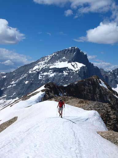 Vern on the summit ridge, with Foster Peak behind