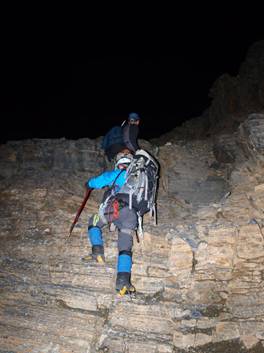 Ben scrambling up the head-wall in dark
