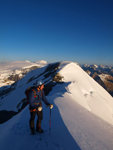 Grant going up the summit ridge. Silverhorn behind