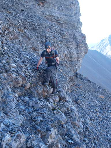 Mike on the typical typical terrain. Loose rubble on down-sloping ledges.