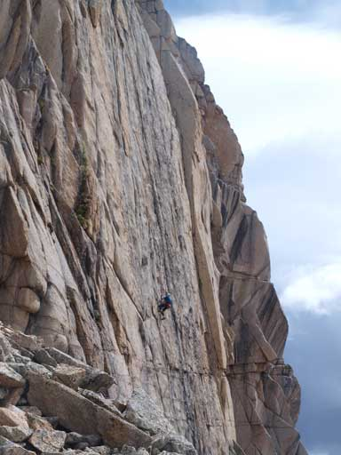 A solo climber raps off one of the many technical routes.