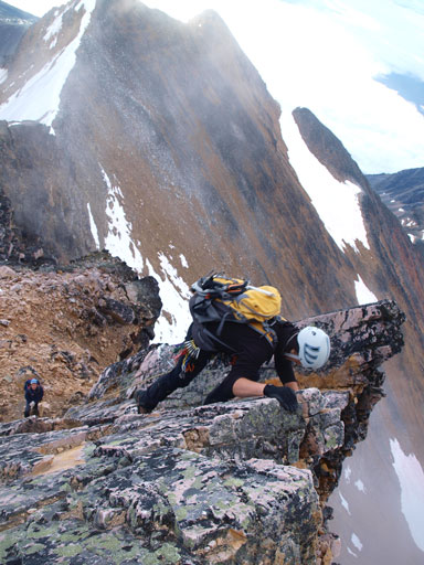 They let us pass eventually. I led up the 1st crux. This is one of these Calgarians climbing up.
