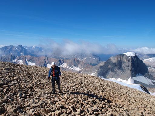 Rod coming up the broad summit ridge