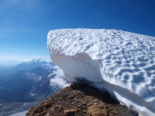 A big cornice on the false summit. We went around it on climber's left side