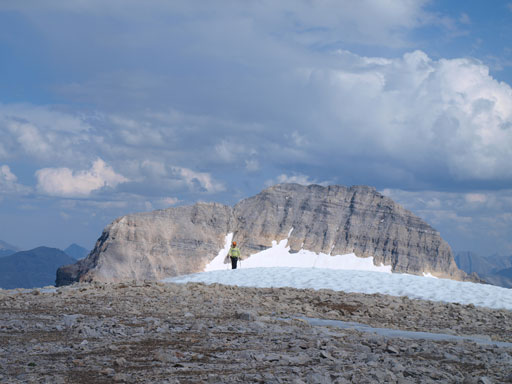 Dan coming to the summit of Strom, with Mount Magog behind
