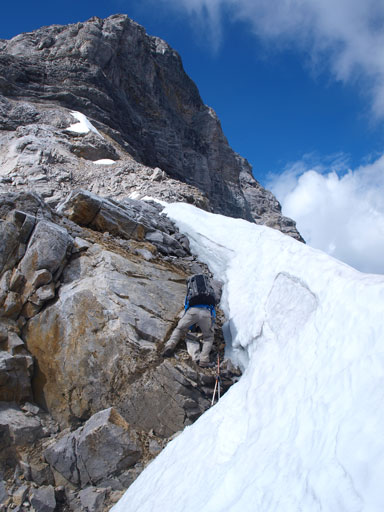 Down-climbing beside a snow scoop. The snow was rock hard so we couldn't use it