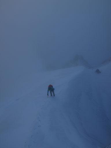 Vern climbing up a snow arete