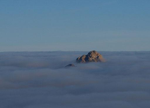 Recondite Peak is the bigger island. Mount Augusta is the tiny one.