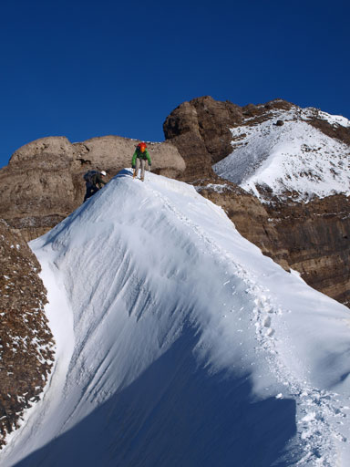 Descending the lower and wider snow arete
