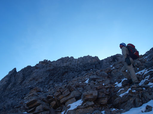Liam scrambling up Pika Peak