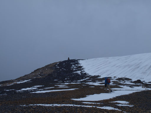 Near the summit, the gigantic cairn is visible