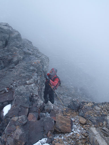 Laurens coming up the scrambling move on the descent. Typical weather too...