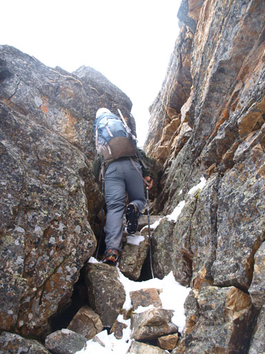 Scrambling up a chimney to get to Myosotis Lake