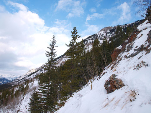 Steep, thin terrain at the lower slopes. I had to take the snowshoes off briefly
